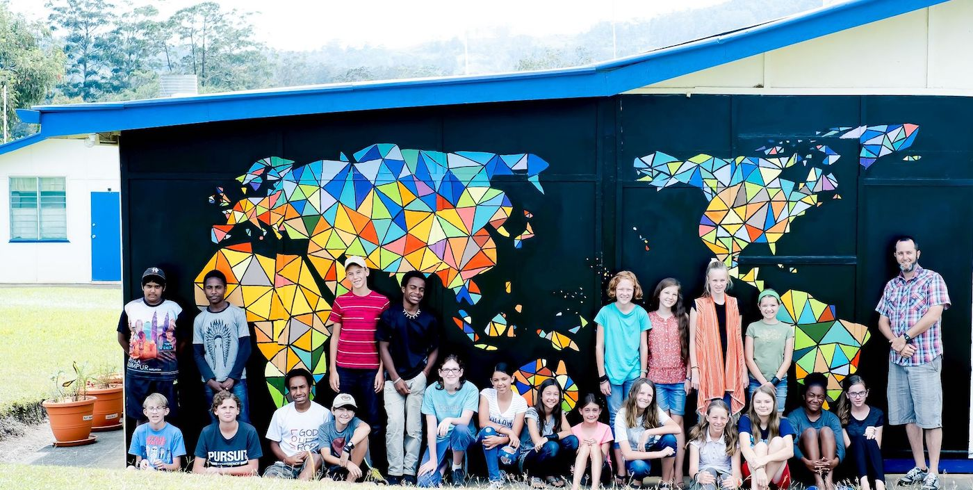 https://go.teachbeyond.org/site-content/uploads/sites/12/2020/06/world_art_mural_at_uis_wtih_middle_school_students_who_painted_it.jpg